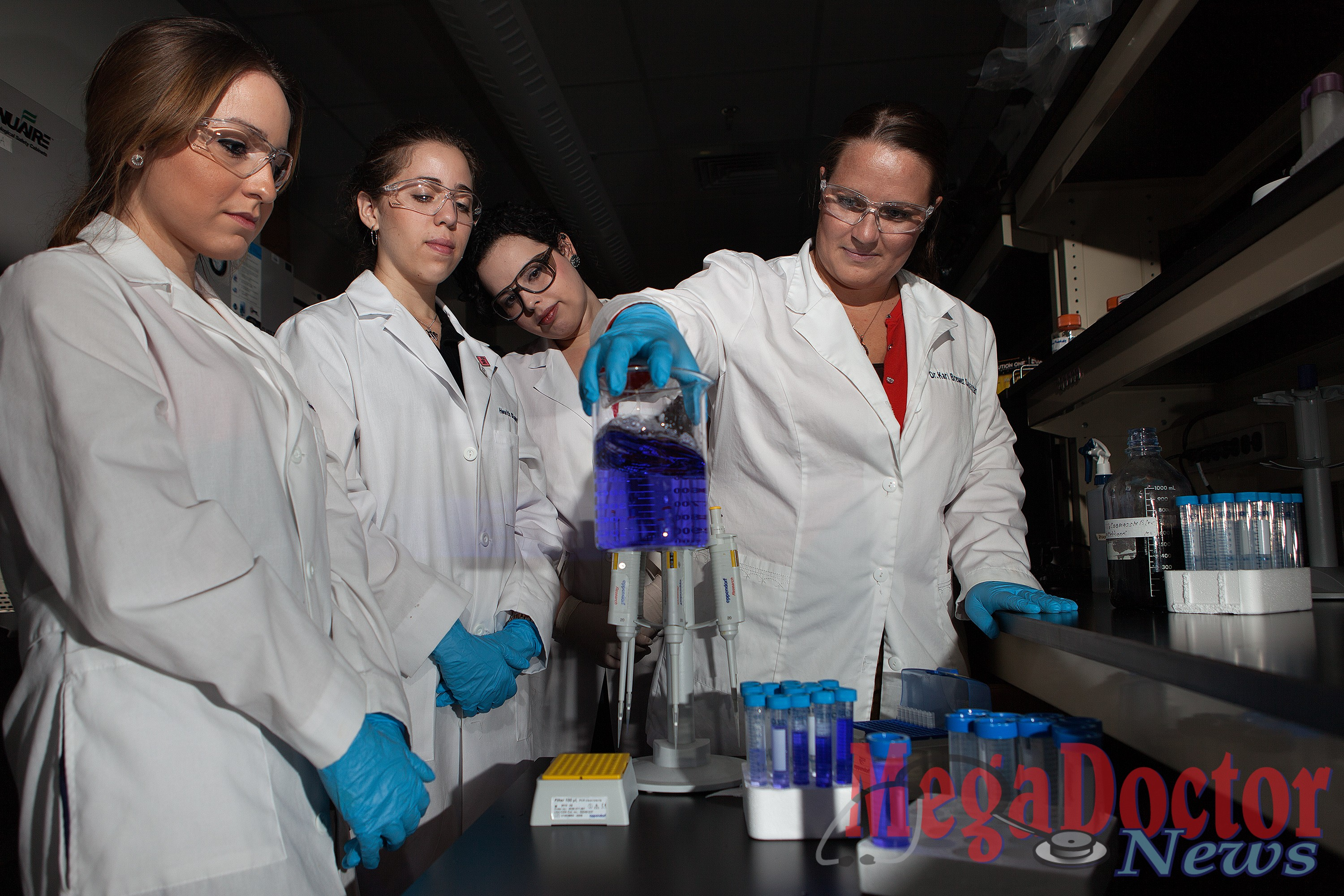Dr. Kari Brewer-Savannah, right, works with students Andrea Fragoso, Miriam De Leon and Erica De Leon in a Biomedical Research Building laboratory. Paul Chouy / UT Brownsville