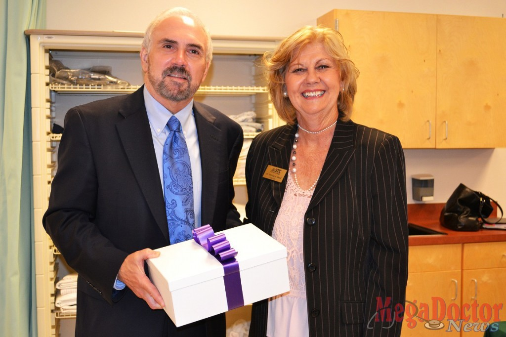 STC President Dr. Shirley A. Reed presents UTRGV President Dr. Guy Bailey with a gift to welcome him to the STC Nursing & Allied Health Campus in McAllen.