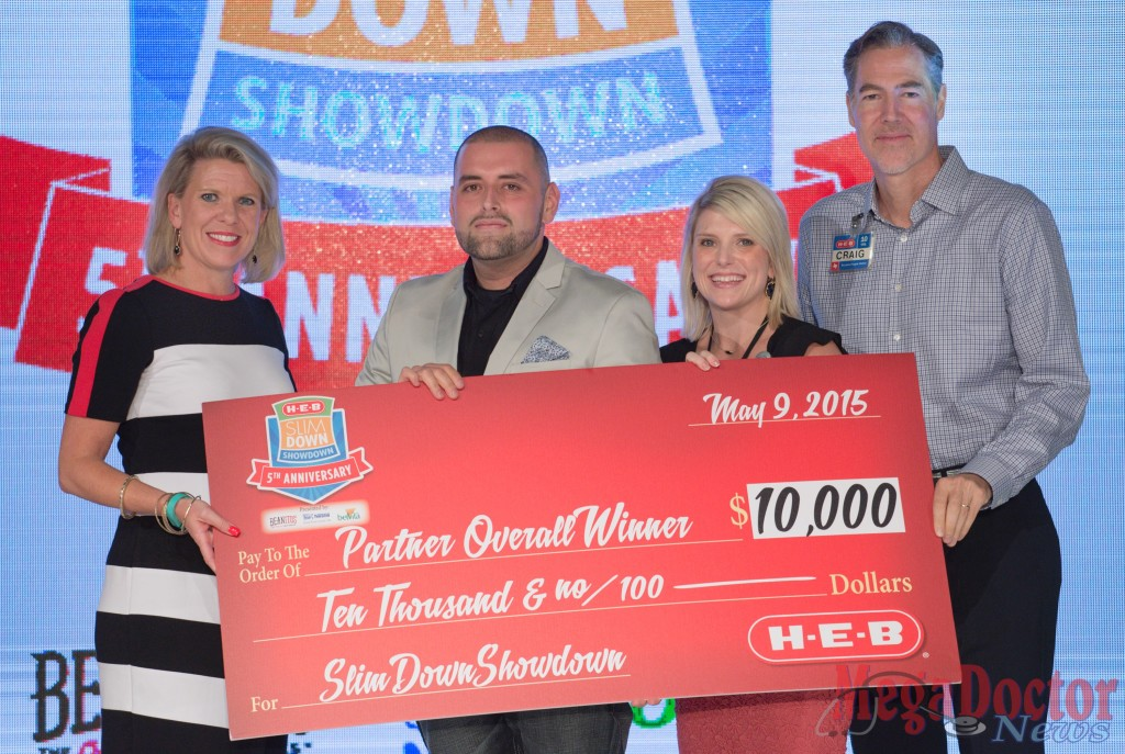 Kate Rogers (L-R), H-E-B VP of communications and engagement, partner overall winner Fred Trevino, H-E-B business development manager Heidi Deen, and Craig Boyan, H-E-B President and COO, post for a photograph during the H-E-B Slim Down Showdown, Saturday, May 9, 2015, in San Antonio, Texas.