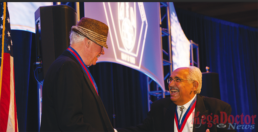 At left: Dr. Jay Scully, immediate past president of the American College of Psychiatrists and former CEO and medical director of the American Psychiatric Association, shakes hands with Dr. Francisco Fernandez, current president of the ACP and founding dean of the UTRGV School of Medicine. The medal Fernandez is wearing is the Bowis Award, presented each year by The College to a member who has played an important leadership role in the organization. The award consists of a gold medallion and a certificate, and the recipient receives travel, hotel and free registration at the annual meeting. Photo by Kevin Shick