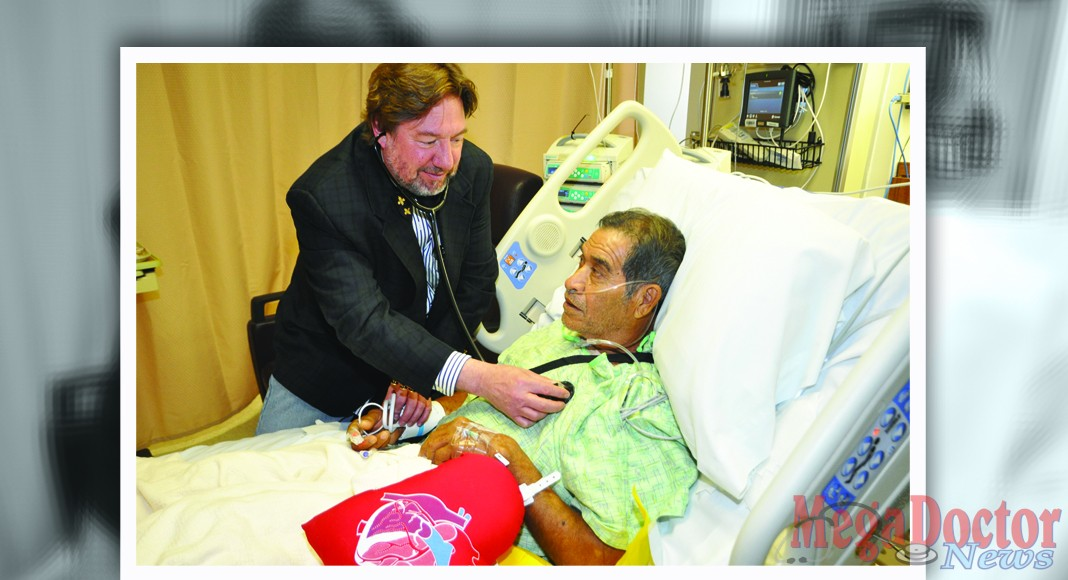 Dr. Mark Morales, a new Cardiovascular Surgeon who is now performing minimally-invasive heart surgeries in Harlingen and Brownsville, checks on patient Jacobo Salinas at Valley Baptist Medical Center in Harlingen.