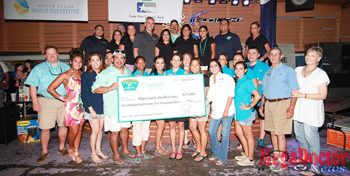 """Pictured above: $275,000 check presentation at the 10th Annual """"Fishing for Hope"""" tournament.  (from left to right) [back row] Israel Rocha, CEO, DHR; Marissa Castaneda, Senior Executive Vice President, DHR; Dr. Robert Martinez, Chief Physician Executive and Chief Medical Officer, DHR; Kelli Owen Quin, Manager of Corporate Communications, DHR; Chico Meyer, Vice President of Special Projects, DHR; Kristina Moran, Physician Relations Coordinator, DHR; Dr. Noel Oliveira; Minerva Echols, Events Representative, DHR; Dr. Carlos Cardenas, Chairman of the Board, DHR; Elisa Mares, Community Events Coordinator, DHR; Mario Lizcano, Director of Corporate Affairs, DHR; Susan Turley, President, DHR. [front row] Michael Koch, Board Member, HFHC; Laura Peñna; Yvette Ramos, Board Member, HFHC; George Garcia, Board Member, HFHC; Dr. Raul Barreda; Thabiso Batsell, HFHC; Roxanne Pacheco, HFHC; Rebecca Stocker, Executive Director, HFHC; Nancy Saenz, HFHC; Zelena Escobar, Board Member, HFHC; Elsa Menchaca; Angie Neely, HFHC; Denis Avitia, HFHC; Gina Solis, HFHC; Edward Arteaga, HFHC; Dr. Alberto Gutierrez; Clare Gutierrez, Board Member, HFHC."""