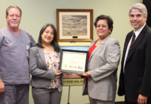 Florestela Delgado of the San Antonio Eye Bank, second from left, presents an award to Knapp Medical Center for helping in efforts to heal the blind through a cornea donation program. Accepting the award are Tony Ashley, RN, Knapp Medical Intensive Care Unit Director; Anna Hinojosa, Chief Nursing Officer for Knapp Medical Center; and Knapp CEO Rene Lopez.