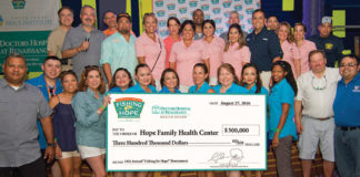 "Check presentation at the 11th annual ""Fishing for Hope"" tournament.  (From left to right) [back row] Dr. Dan Guerra, DHR; Dr. Carlos J. Cardenas, Chief Administrative Officer and Chairman of the Board, DHR; Dr. Juan C. Bernini, DHR; Dr. Raul Barrerda, DHR; Lisa Nunez, Business Development Manager, DHR; Susan Turley, President, DHR; Minerva Echols, Events Representative, DHR; Travis McAlpine, Business Development Manager, DHR; Elisa Mares, Community Events Coordinator, DHR; Dr. Robert Martinez, Chief Medical Officer, DHR; Kristina Moran, Physician Relations Coordinator, DHR; Mario Lizcano, Director of Corporate Affairs, DHR; Danny Moran, DHR; Prysilla Jasso, Executive Director, Border Health PAC;  Marissa Castaneda, Senior Executive Vice-President, COO, DHR.[front row] Frank Nunez, Director of Security, DHR."