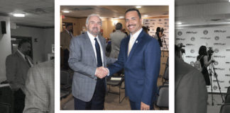 Dr. Guy Bailey, President of the University of Texas RGV, shakes hands with Dr. Ambrosio Hernandez, mayor of the City of Pharr. Mayor Hernandez had just delivered $500,000 commitment to help the medical school. Photo by Roberto Hugo Gonzalez
