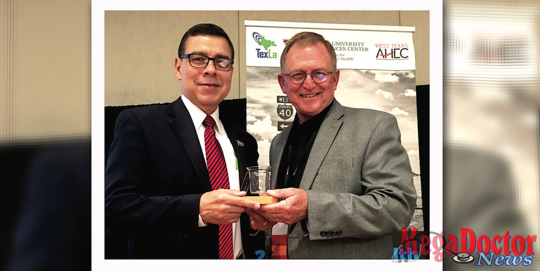 Dr. Leonel Vela (at left), UTRGV senior associate dean for Education and Academic Affairs and chair of the Department of Medical Education, has been recognized by the Texas Tech University Health Sciences Center F. Marie Hall Institute of Rural and Community Health – which he established during his time at Texas Tech – for his role in expanding access for the under-served in the state. He is shown here with his 2017 Rural Health Visionary Award with Dr. Billy Phillips, executive vice president of the institute.(Courtesy Photo)
