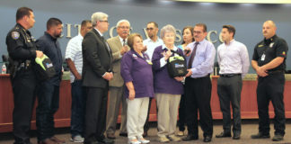 Dr. Robert Sepulveda, fifth from left, Internal Medicine Physician in Weslaco, speaks on the importance of defibrillators in helping people to survive heart attacks, while hospital volunteers with Knapp Medical Center present a donation of the life-saving devices to the City of Weslaco Police Department. From the left are Weslaco Police Chief Stephen Scot Mayer; Weslaco City Commissioner Josh Pedraza; Mayor Pro-Tem Jerry Tafolla; Rene Lopez, CEO for Knapp Medical Center; Dr. Robert Sepulveda; Anita Vallejo, Vice President for Projects for the Knapp Volunteer Auxiliary; Commissioner Leo Muñoz; Bernice Nittler, Immediate Past President of the Knapp Volunteer Auxiliary; Commissioner Letty Lopez; Weslaco Mayor David Suarez; Commissioner Greg Kerr; and Weslaco Fire Chief Antonio Lopez.