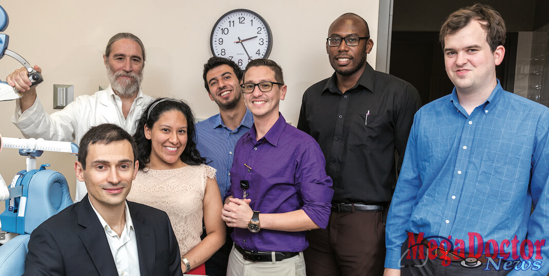 Dr. Gabriel De Erausquin (back row, at left), professor and founding chair of the UTRGV School of Medicine's Department of Psychiatry, Neurology and Neurosciences, is shown here with the first cohort of UTRGV psychiatry residents: (front row, seated) Dr. Andry Shalomov, 35, American University of the Caribbean School of Medicine, Sint Maarten; (standing, middle row, from left) Dr. Lessley Chiriboa, 28, Rutgers University, Robert Wood Johnson Medical School; Dr. Karel de Leon, 34, Universidad Nacional Autónoma de México, Facultad de Medicina; Dr. Scott Wallace, 28, University of Arizona – Tucson College of Medicine; (back row, center) Dr. Camille Merhi, 25, University of Balamand, Faculty of Medicine and Medical Sciences, Lebanon; and Dr. Karachí Igwe, 29, St. George's School of Medicine, Grenada. Mega Doctor News (UTRGV Photo by David Pike)