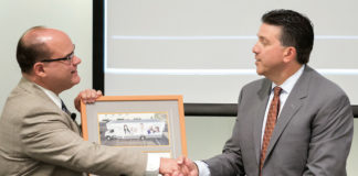 Dr. John Krouse (at left), dean of the UTRGV School of Medicine and vice president for Health Affairs, and Dave Milich, CEO of UnitedHealthcare Texas/Oklahoma, exchanged plaques during an event on Thursday, Sept. 28, 2017, at the Medical Education Building on the UTRGV Edinburg Campus. The event was to celebrate the partnership between the UTRGV School of Medicine and the United Health Foundation that helped bring about the Unimóvil mobile clinic. Mega Doctor News (UTRGV Photo by Paul Chouy)
