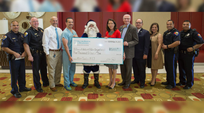 DHR Health presents a $5,000 donation to Edinburg Police Chief David Edward White and the Edinburg Police Department for the 25th Annual Blue Santa Christmas Toy Drive.