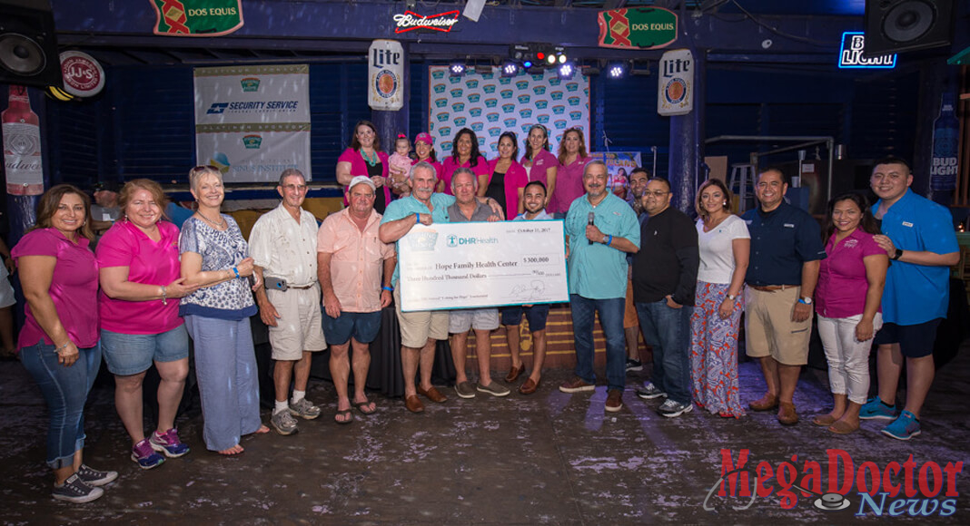 "Pictured Above: DHR Health presents the Hope Family Health Center with a check for $300,000 at the 12th Annual ""Fishing for Hope"" Tournament in 2017."