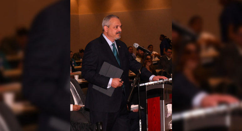 Dr. Carlos Cardenas as he delivers his testimony before the Humans Services committee. Photo by Roberto Hugo Gonzalez