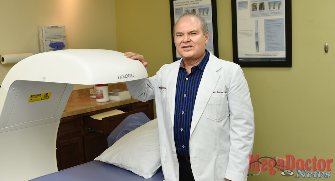 Dr. Sanchez with the DEXA Scan, an instrument used to measure bone density.