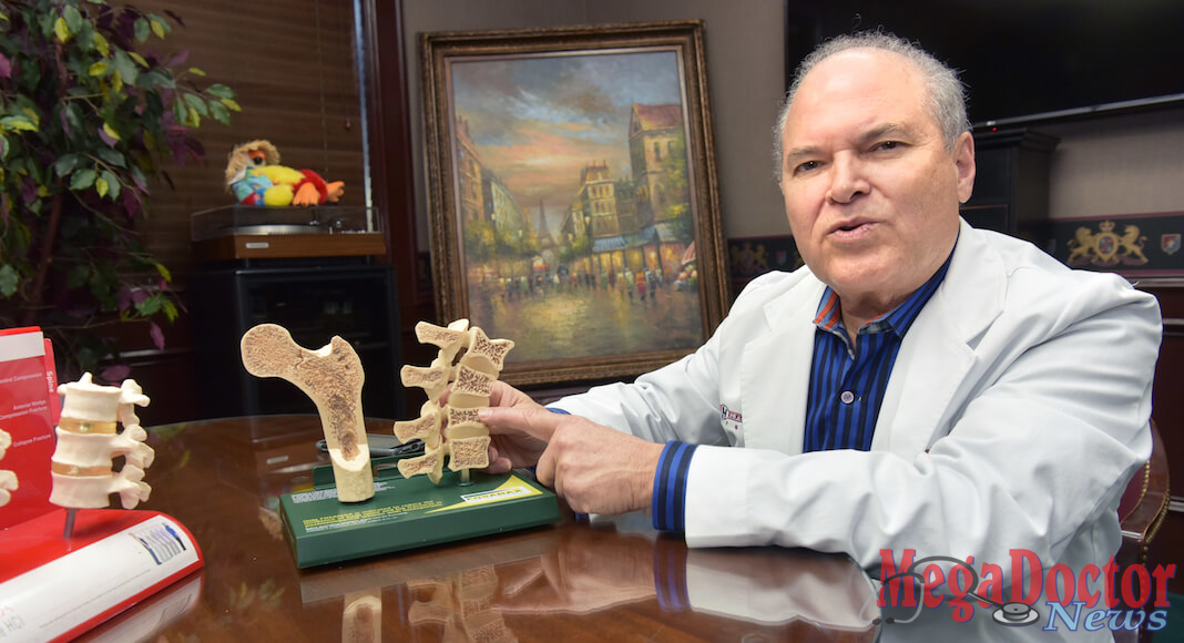 Dr. Manuel J. Sanchez, showing a bone model
