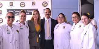 Mayor Ambrosio Hernandez, M.D. (center) and Dr. Annabelle Palomo (to his right) celebrate alongside current RGV College nursing students.