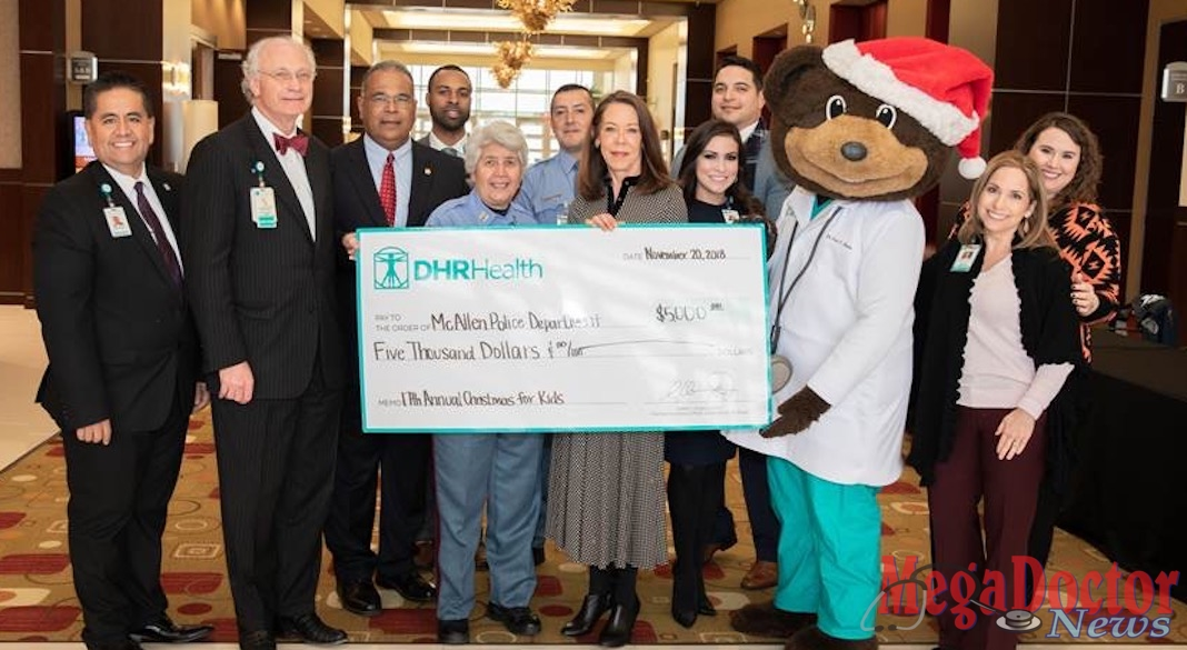 """DHR Health presents a $5,000 donation to McAllen Police Chief Victor Rodriguez and the McAllen Police Department for the 17th Annual McAllen Police Department """"Christmas for Kids"""" Toy Drive."""