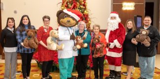 Pictured above: DHR Health receives a donation of teddy bears from Paula Owen and Irene Quail, representing the Rio Grande Chapter National Society Daughters of the American Revolution. Pictured from left to right: Norma Teran, DNP, MBA, RN, Chief Nursing Officer, DHR Health; Elizabeth Adamson, DNP-HI, MSN, RN, BC, Chief Nursing Information Officer, DHR Health; Lesley Anne Durant, JD, CHC, CHPC, Chief Compliance and Privacy Officer, DHR Health; Dr. Ted E. Bear; Paula Owen; Irene Quail; Lisa R. Treviño, PhD, Vice President for Research and Development; Mario Garza. Jr., MSN, RN, Vice President of Surgery and Procedural Services, DHR Health.