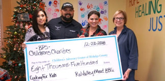 Yadi Robles, Fred Robles presenting check to Children's Advocacy Center Development Directors Tracy Gerdes and Pat Blum.