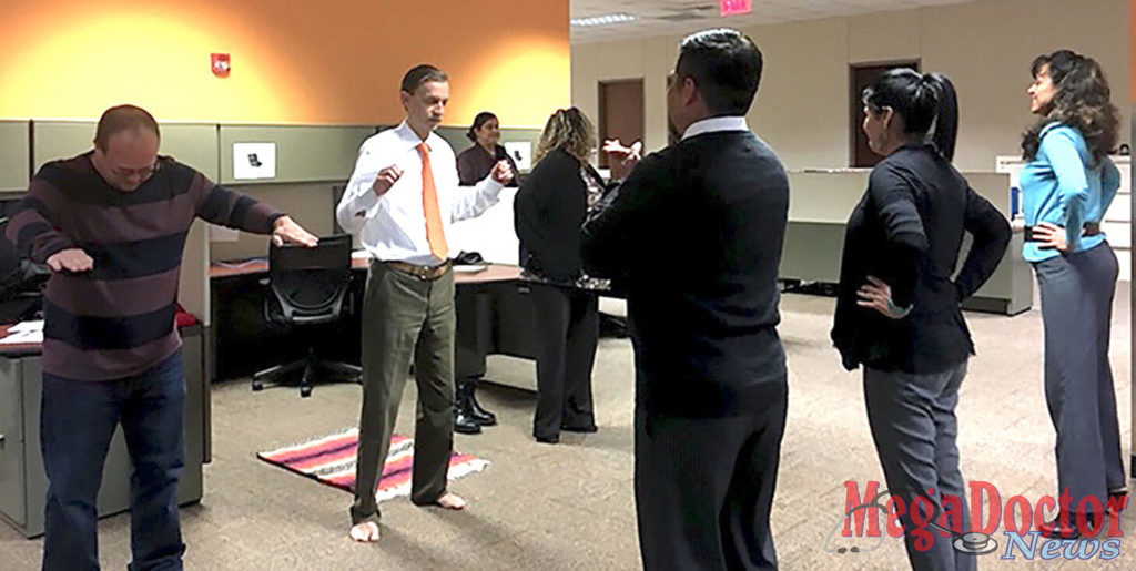 Each workday, at 9 a.m., 11 a.m., and 4 p.m., employees step away from their desks to participate in short exercise sessions led by Elma Vega, an administrative assistant in the UTRGV Department of Population Health and Biostatistics.