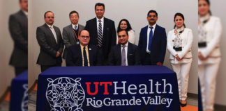 Dr. John H. Krouse (seated, at left), UTRGV executive vice president for Health Affairs and dean of the UTRGV School of Medicine, recently welcomed Dr. Subhash C. Chauhan, Ph.D. (seated, at right), as founding director of the South Texas Center of Excellence in Cancer Research and chair of the Department of Immunology and Microbiology at the UTRGV School of Medicine. Also present at the welcoming ceremony were Dr. Andrew Tsin (standing, second from left), UTRGV associate dean of Research; and Chauhan team members (from left) Dr. Manish Tripathi (far left), Dr. Bilal Hafeez (third from left), Dr. Meena Jaggi, Dr. Murali Yallapu and Dr. Sheema Khan. (Courtesy Photo)