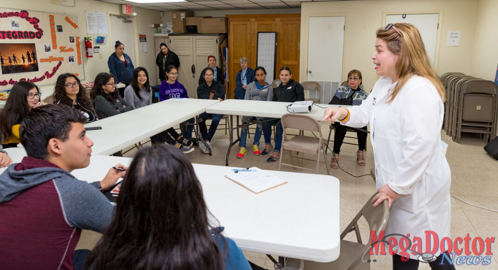 Dr. Gladys Maestre (standing, at right), a UTRGV professor of neuroscience and human genetics and director of the UTRGV Alzheimer´s Disease Resource Center for Minority Aging Research, is seen here working with a group of high school students known as the center's Alzheimer's Ambassadors. The center provides education, mentoring and support for the ambassadors, Maestre said, so they can go to events and into the community to become the voice of people with Alzheimer's and their caregivers. (UTRGV Photo by David Pike)