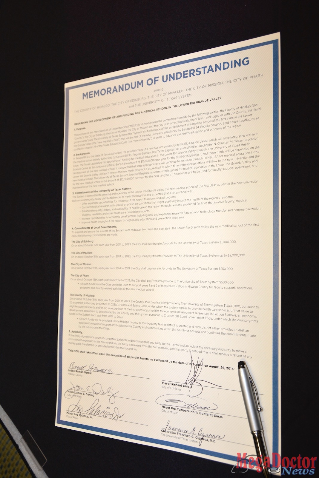 This is the Memorandum of Understanding executed by six leaders committing to fund the school of medicine. Photo by Roberto Hugo Gonzalez August 2014