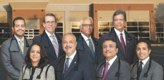 "From DHR Health Gastroenterology Institute (Front row from L-R) Dr. Ingrid Chacon; Dr. Carlos J. Cardenas; Dr. Asif Zamir, FACG; Dr. Ramakrishna ""Rama"" Behara, DO; (Back row from L-R) Dr. Henry Herrera; Dr. Subrahmanyam Behara; Dr. Gregg Wendorf; Dr. S. Murthy Badiga."